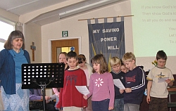 Children participate in the service